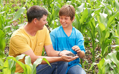 Dad and son in corn field